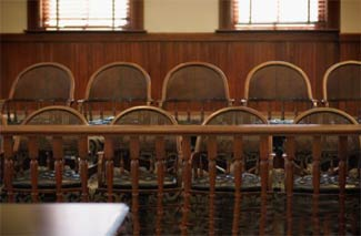 Empty chairs in a jury box