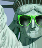 photograph of statue of liberty wearing green sunglasses